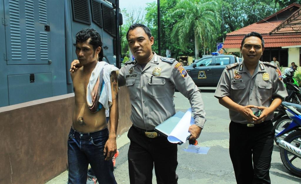 Pelaku saat diamankan di Polresta Padang. FOTO/CC